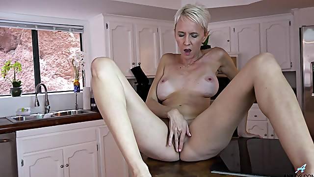 Dirty mature Madison Mayhem loves masturbating in the kitchen