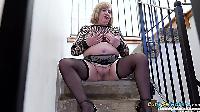 Mature lady Auntie Trisha playing with her chunky body all alone and fingering her wet pussy