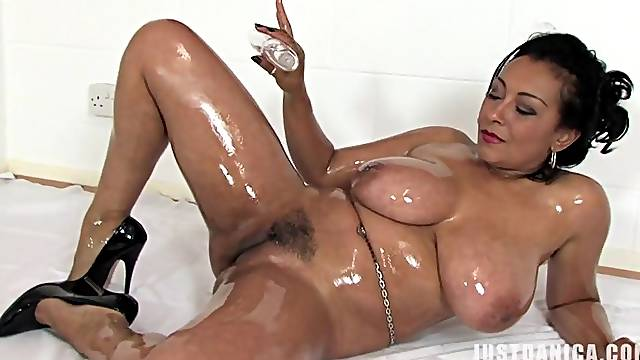 Oiled mature Danica Collins knows how to pleasure her cravings