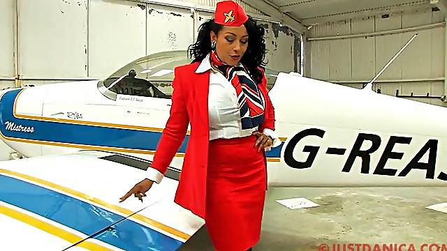 Busty stewardess Danica Collins takes off her panties to tease