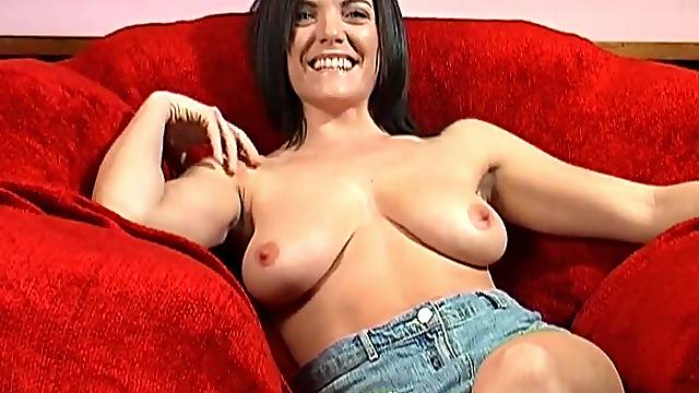 Busty amateur model Rebekah Dee takes off her shorts and masturbates
