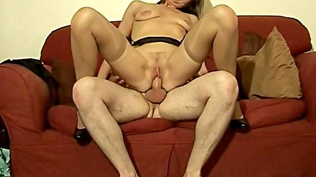 Saggy boobs wife Julie Brown gives head and rides on the sofa