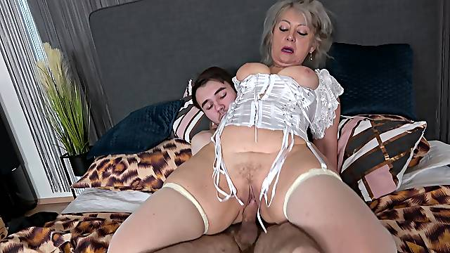 Horny granny in white stockings gets fucked by a dude with a giant dick