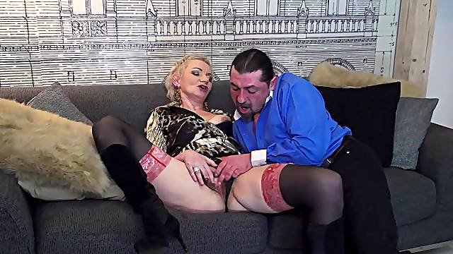 Horny mature wife Elena enjoys riding his stiff dick on the sofa