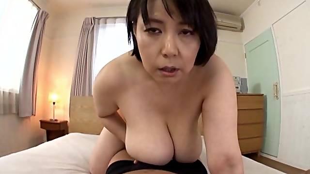 Chubby Japanese mature Misuzu Tomizawa knows how to give a titjob