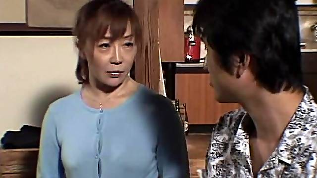 Horny Japanese wife drops on her knees to pleasure a stiff cock