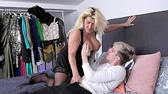Younger man with a stiff cock fucks wet pussy of mature Lola Wild