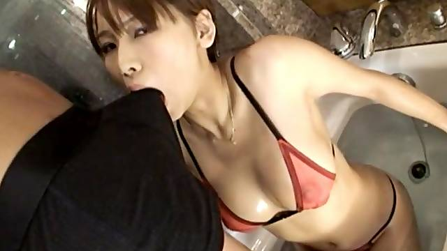 Provocative Asian escort in thong and stockings gives the best BJ