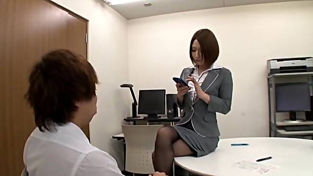 Amazing secretary plays with her pussy and gives a footjob to her boss