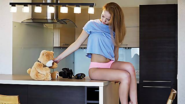 Skinny model Faina loves playing with her pussy in the kitchen