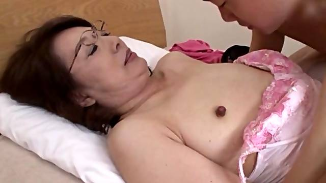 Horny Japanese cougar takes a stiff cock in her tight hairy pussy