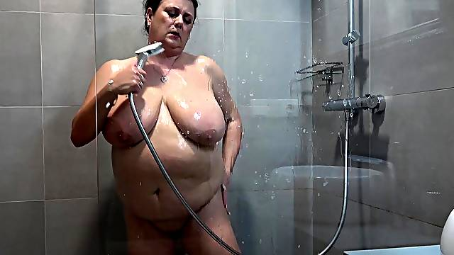 Brunette BBW teasing with her smoking hot body while taking a shower