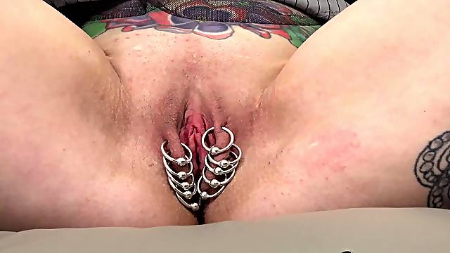 Inked MILF shows her pussy piercings
