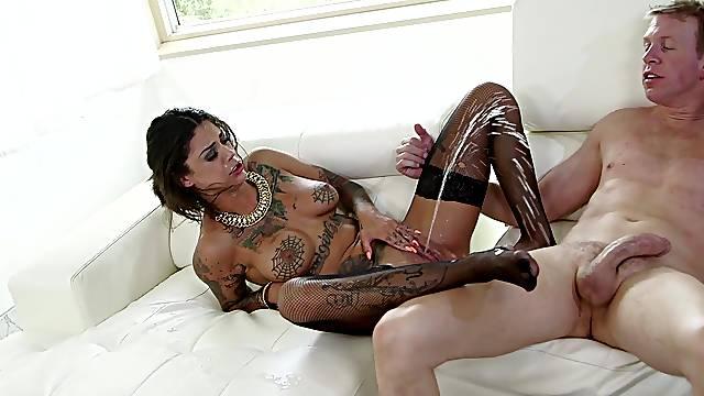 Tattooed hottie Bonnie Rotten enjoys riding a large manhood