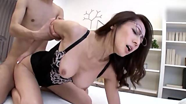Horny Asian mature with glasses spreads legs to be fucked hard