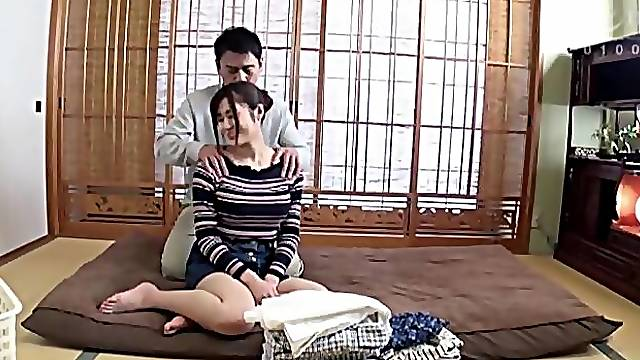 Oiled Haruka Mirai moans while her pussy is being fingered