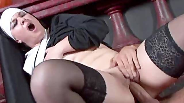 Nun in stockings loves shaved pussy sex