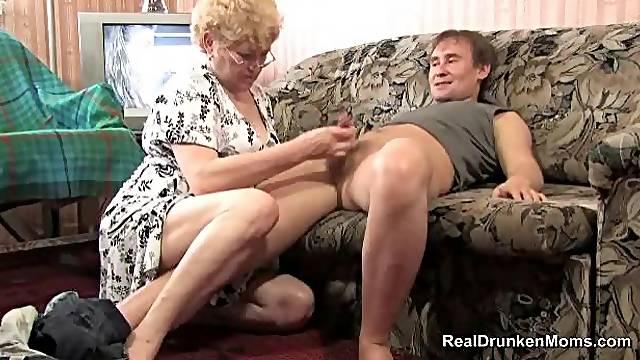 Granny in glasses sucks a cock