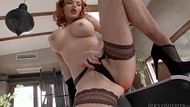 Glamorous redhead in lingerie strips solo