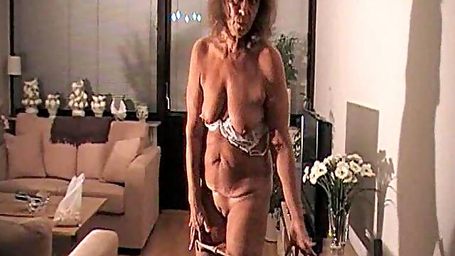 Granny wears pantyhose and teases her pussy
