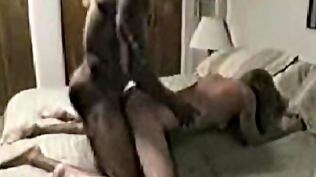 Husband watches while wife takes black