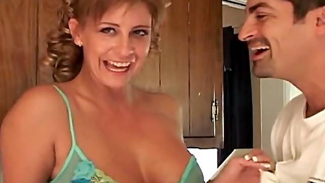 Housewife in kitchen teases in sheer lingerie