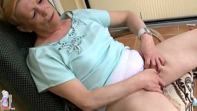 Granny masturbates on deck in panties