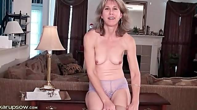 Solo mature Olive Jones striptease porn video