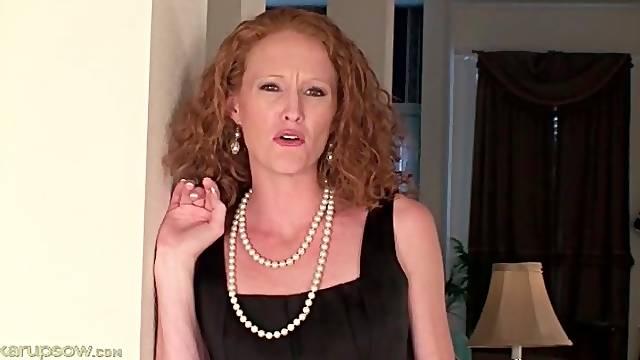 Skinny redhead milf strips off her little black dress