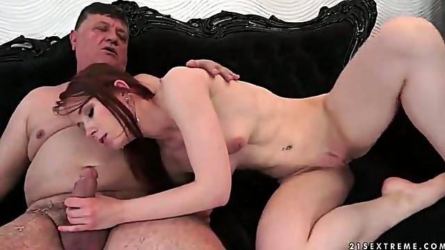 Tight young redhead sits on old man dick