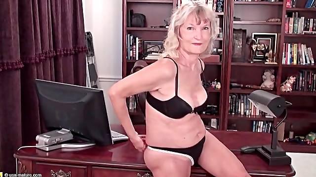 Granny striptease in her office