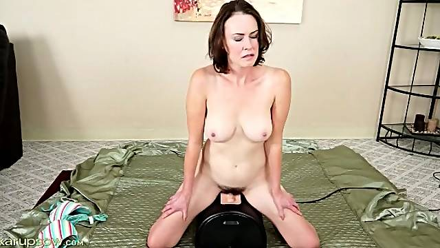 Mom with great tits rides a Sybian toy