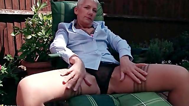 Short hair granny in sexy stockings outdoors