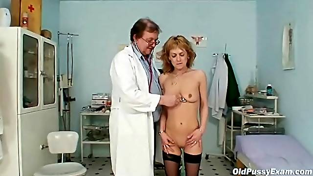Mature slut strips to stockings for a gyno exam