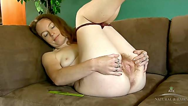 Hairy all over girl combs her armpit hair
