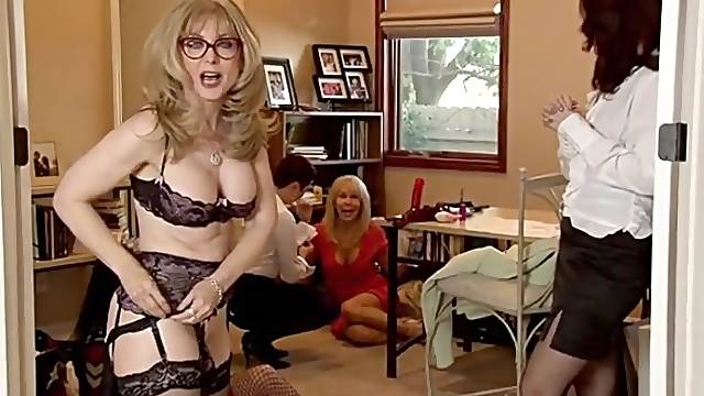 Lingerie milf poses for topless pictures