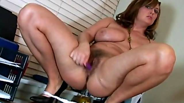 Curvaceous beauty with a hot bush fucks her toy