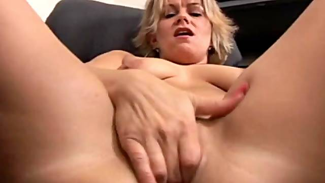 Naked masturbating mom in an office chair