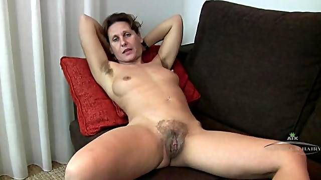 Milf grows a nice collection of hair in her armpits