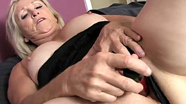 Freckled granny plunges a toy into her wet cunt