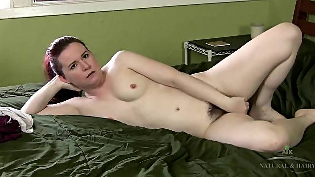 Amateur has her legs open and her hairy pussy on display