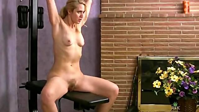 Mom with a sexy bush does a naked workout