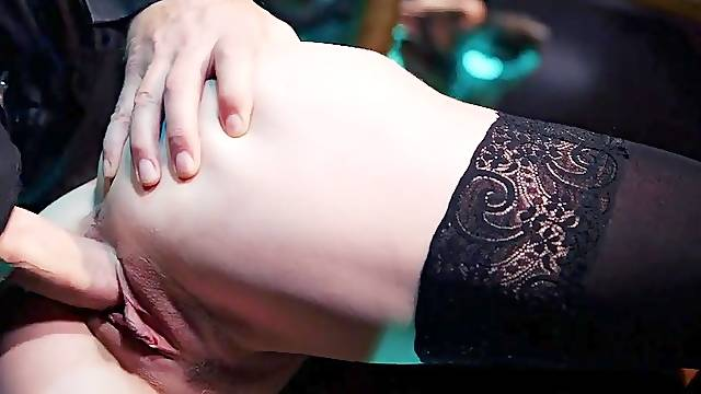 Stripper in a corset and stockings fucks a client