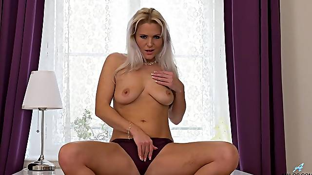 Tight purple panties cling to her perfect milf ass