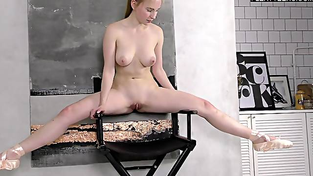Cute girl in ballet flats has a super flexible body