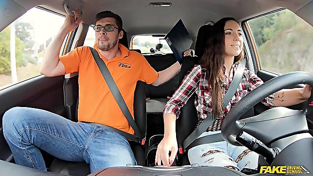 First driving lesson and she fucks with her driving instructor