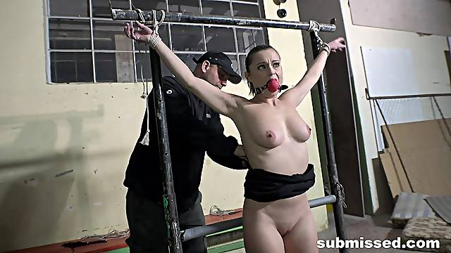 Busty nude girl acts submissive in the face of her master