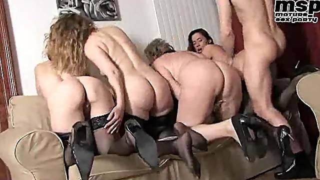 Four mature women joined by young man
