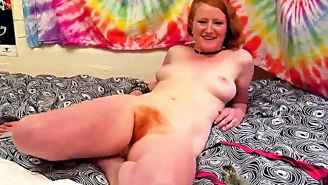 Teen redhead with fire in the bush