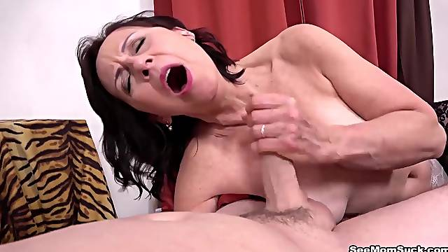 Mom Danina catches  guy jerking off and gives him a blowjob